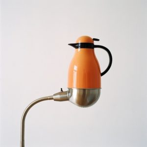 Thermos placed on lamp, 2012 © Jakob Hunosøe/Peter Lav Gallery