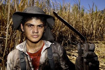 Jose Oscar Rivas Vasquez, 19, works in the sugar cane fields of El Angel Sugar Mill (Ingenio El Angel) outside of Suchitoto, El Salvador on Jan. 12, 2015.